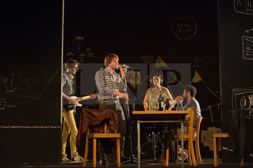 """© Licensed to London News Pictures. 24/09/2014. London, England. L-R: Moritz Gottwald; Christoph Gawenda, Eva Meckbach and Renato Schuch. German theatre company Schaubühne Berlin present an adaptation of """"An Enemy of the People"""" by Henrik Ibsen at the Barbican Theatre, Barbican Centre, from 24-28 September 2014. The play is directed by Thomas Ostermeier and part of the International Ibsen Season. Photo credit: Bettina Strenske/LNP"""