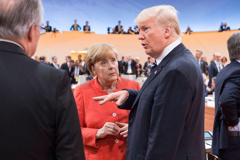 07 JUL 2017, HAMBURG/GERMANY:<br /> Angela Merkel (L), CDU, Bundeskanzlerin, und Donald Trump (R), Praesident Vereinigte Staatsn von America, USA, im Gesprech, vor Beginn der 1. Arbeitssitzung, G20 Gipfel, Messe<br /> IMAGE: 20170707-01-022<br /> KEYWORDS: G20 Summit, Deutschland, Gespräch