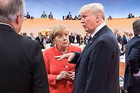 07 JUL 2017, HAMBURG/GERMANY:<br /> Angela Merkel (L), CDU, Bundeskanzlerin, und Donald Trump (R), Praesident Vereinigte Staatsn von America, USA, im Gesprech, vor Beginn der 1. Arbeitssitzung, G20 Gipfel, Messe<br /> IMAGE: 20170707-01-022<br /> KEYWORDS: G20 Summit, Deutschland, Gespr&auml;ch