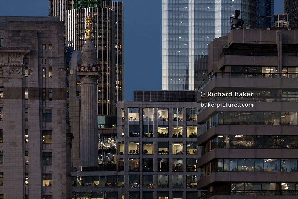 Evening generic office buildings in the City of London - the capital's financial district (aka The Square Mile), on 2nd November 2018, in London, England.