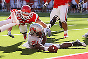 UNLV quarterback Omar Clayton (2) is tripped up just short of the end zone by Utah linebacker Boo Anderson (45) during the last play of the game in the fourth quarter an NCAA college football game at Rice-Eccles Stadium, Saturday, Sept. 11, 2010, in Salt Lake City, Utah.  Utah defeated UNLV 38-10. (AP Photo/Colin E. Braley)