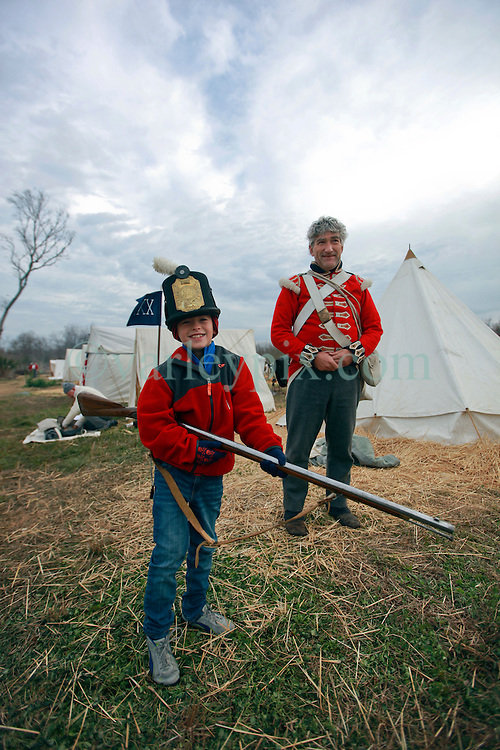 11 January 2015. New Orleans, Louisiana. <br /> Bicentennial reenactment of the Battle of New Orleans in Chalmette. <br /> Ben and Phillip Dye of the Royal Welsh Fuseliers of the British forces prepares to re-enact the January 8th, 1815 disastrous battle against American foes marking the 200th anniversary of the Battle of New Orleans in Chalmette. Despite heavily outnumbering the Americans, the British suffered over 2,000 casualties, with many senior officers amongst the dead and injured compared to the Americans who suffered a mere 70 by comparison. The American victory was hailed as miracle.<br /> Photo; Charlie Varley/varleypix.com