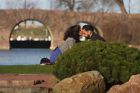2463 &ndash; A couple enjoy the afternoon Sunday in the Japanese Garden located in Jackson Park.<br /> <br /> Please 'Like' &quot;Spencer Bibbs Photography&quot; on Facebook.<br /> <br /> All rights to this photo are owned by Spencer Bibbs of Spencer Bibbs Photography and may only be used in any way shape or form, whole or in part with written permission by the owner of the photo, Spencer Bibbs.<br /> <br /> For all of your photography needs, please contact Spencer Bibbs at 773-895-4744. I can also be reached in the following ways:<br /> <br /> Website &ndash; www.spbdigitalconcepts.photoshelter.com<br /> <br /> Text - Text &ldquo;Spencer Bibbs&rdquo; to 72727<br /> <br /> Email &ndash; spencerbibbsphotography@yahoo.com