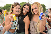 Members of the Red Bull Wings Team gifting cans of Red Bull to attendees at the Firefly Music Festival in Dover, DE on June 18, 2015.