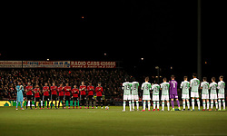 The two team's stand for a minute's applause to remember Jimmy Armfield, who died this week, during the Emirates FA Cup, fourth round match at Huish Park, Yeovil.