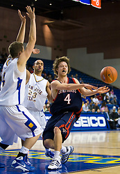 November 30, 2009; San Jose, CA, USA;  Saint Mary's Gaels guard Matthew Dellavedova (4) passes to avoid San Jose State Spartans forward Kyle Thomas (4) and guard Robert Owens (23) during the second half at the Event Center Arena.  Saint Mary's defeated San Jose State 78-71.