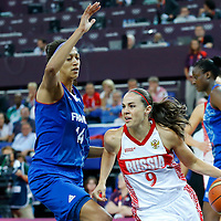 09 August 2012: Russia Becky Hammon drives past France Emmeline Ndongue during 81-64 Team France victory over Team Russia, during the women's basketball semi-finals, at the 02 Arena, in London, Great Britain.