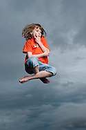 Young girl in mid air, Scotland