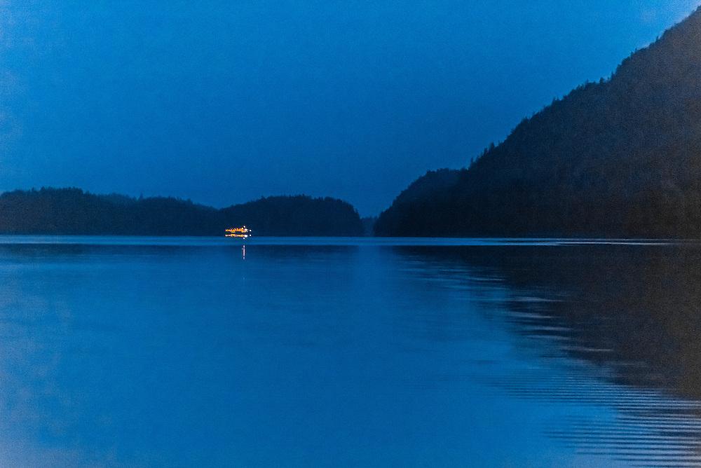 Night scene of a ship passing, Nakwasina Sound,  Inside Passage, Southeast Alaska USA.