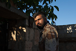 """Syria.<br /> Jamal Maarouf a commander of the FSA enters his secret office with his guards in Idlib province.<br /> <br /> Jamal Maarouf an important commander of the FSA (his group is martyrs of Syria) in the north of Syria gives an interview to the Italian TV channel 7:  """"Europe don't fear us, the syrian revolution did started from the extremist""""  """"I don't believe in eye for eye for eye and tooth for tooth"""" and """"We only need weapons and and if weapons arrived we are able to win the war"""", <br /> Sunday, 16th June 2013<br /> Picture by Daniel Leal-Olivas / i-Images"""