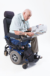 Male wheelchair user reading the newspaper,