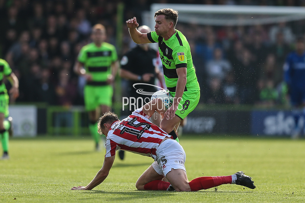 Forest Green Rovers Dayle Grubb(8) and Cheltenham Town's Will Boyle(15) challenge for the ball during the EFL Sky Bet League 2 match between Forest Green Rovers and Cheltenham Town at the New Lawn, Forest Green, United Kingdom on 20 October 2018.