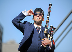 Pictured: Alasdair MacLaren from Glasgow Police Pipe Band soaks up the sun at the launch.<br /> <br /> Glasgow Police Pipe Band were on hand to make sure the launch for this years Piping Live! Glasgow Piping Festival was no quiet affair outside Glasgow Royal Concert Hall.<br /> <br /> © Dave Johnston / EEm