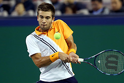 SHANGHAI, Oct. 13, 2018  Borna Coric of Croatia hits a return during the men's singles semifinal match against Switzerland's Roger Federer at 2018 ATP Shanghai Masters tennis tournament in Shanghai, east China, Oct. 13, 2018. (Credit Image: © Fan Jun/Xinhua via ZUMA Wire)