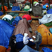 Camp rules are passed out to people living in tents on Wednesday, November 23, 2010 at the Occupy Seattle encampment at Seattle Central Community College. Members of the camp were working to clean trash from the camp as a board of community college trustees were voting to evict Occupy Seattle from Seattle Central Community College campus. (Joshua Trujillo, seattlepi.com)
