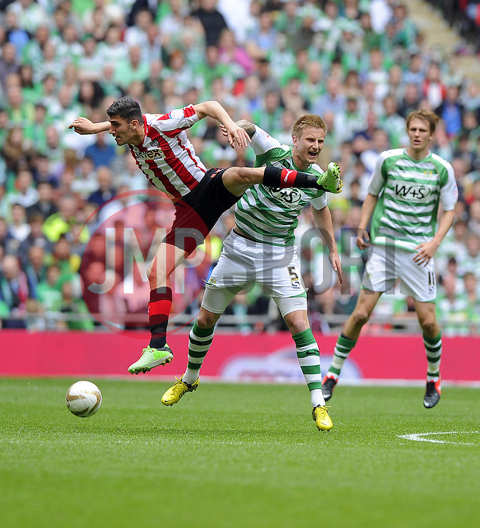 Brentford's Marcello Trotta battles for the high ball with Yeovil Town's Byron Webster - Photo mandatory by-line: Joe Meredith/JMP - Tel: Mobile: 07966 386802 19/05/2013 - SPORT - FOOTBALL - LEAGUE 1 - PLAY OFF - FINAL - Wembley Stadium - London - Brentford V Yeovil Town