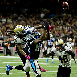 Oct 16, 2016; New Orleans, LA, USA; New Orleans Saints cornerback B.W. Webb (28) knocks a pass away from Carolina Panthers tight end Ed Dickson (84) during the fourth quarter of a game at the Mercedes-Benz Superdome. The Saints defeated the Panthers 41-38. Mandatory Credit: Derick E. Hingle-USA TODAY Sports