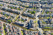 Nederland, Noord-Holland, Amsterdam, 09-04-2014;<br /> Binnenstad en grachtengordel, vbnb Prinsengracht, Keizersgracht, Herengracht, Singel doorsneden door de Raadhuisstraat.<br /> Aan de Prinsengracht Anne Frankhuis (Achterhuis), Westertoren, Westermarkt.<br /> Center and ring of canals of Amsterdam. <br /> The Westerkerk (church) next  to the Achterhuis (now Anne Frank House)  where people are queueing.<br /> luchtfoto (toeslag op standard tarieven);<br /> aerial photo (additional fee required);<br /> copyright foto/photo Siebe Swart