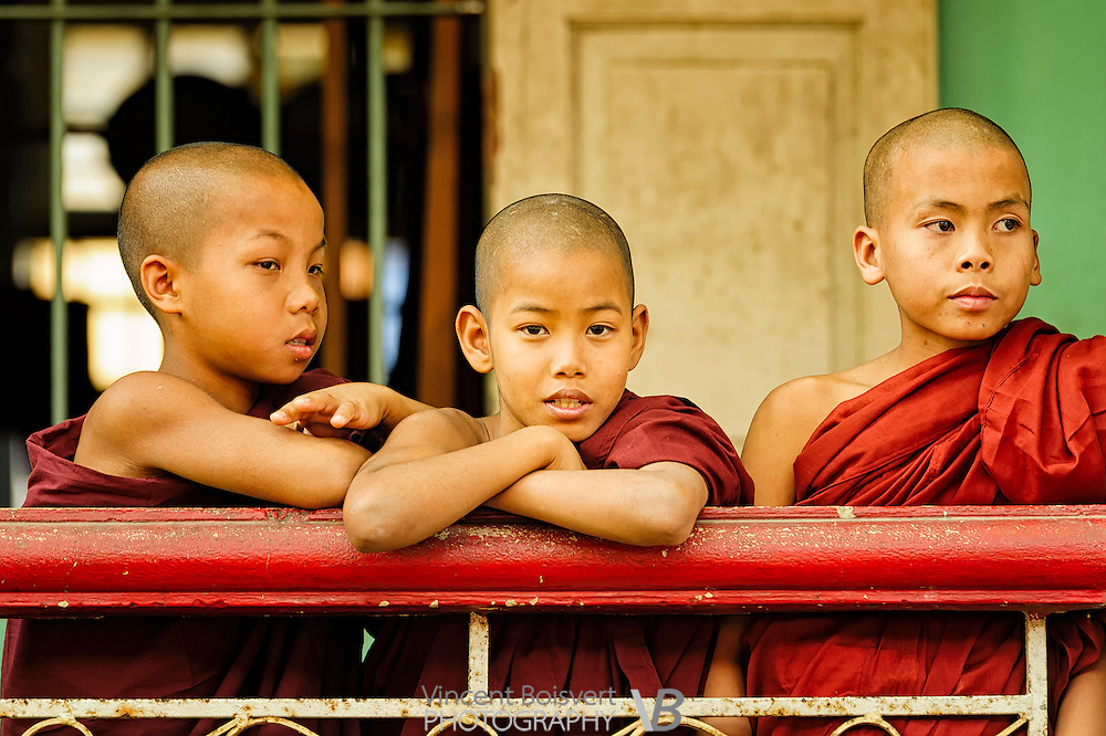 Young buddhist monks on a balcony during the breakfast ceremony in Mahagandayon Monastery, Mandalay, Myanmar