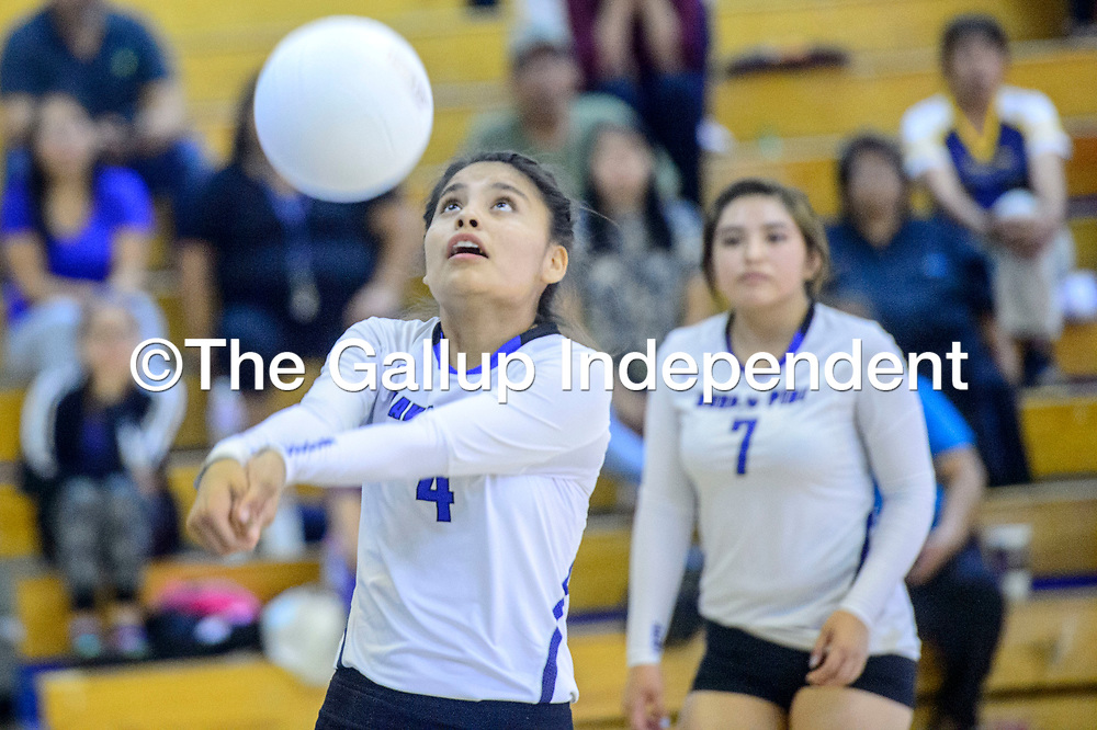 Navajo Pine Warrior Ashliegh Bia (4) volleys ahead of Mariah Yazzie (7) to the Rock Point Cougasr at Navajo Pine High School in Navajo Tuesday.