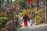 Residents of Mawlynnong village walking in the village.