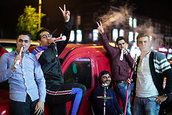 © Licensed to London News Pictures. 04/06/2019. Manchester, UK. People celebrate Eid-ul-Fitr , the end of a month of fasting during Ramadan , in Rusholme in Manchester . Photo credit: Joel Goodman/LNP