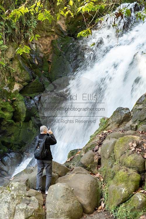 A tourist views the upper Cascada de Texolo waterfall near Xico, Veracruz, Mexico. The remote jungle area was used in filming the movie Romancing the Stone.