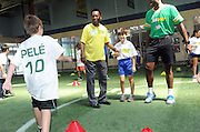 Soccer legend Pele, center, greets soccer campers at Chelesea Piers in New York, Thursday, July 31, 2013, as SUBWAY restaurants names Pele as their newest global brand ambassador.  (Photo by Diane Bondareff/Invision for SUBWAY restaurants/AP Images)