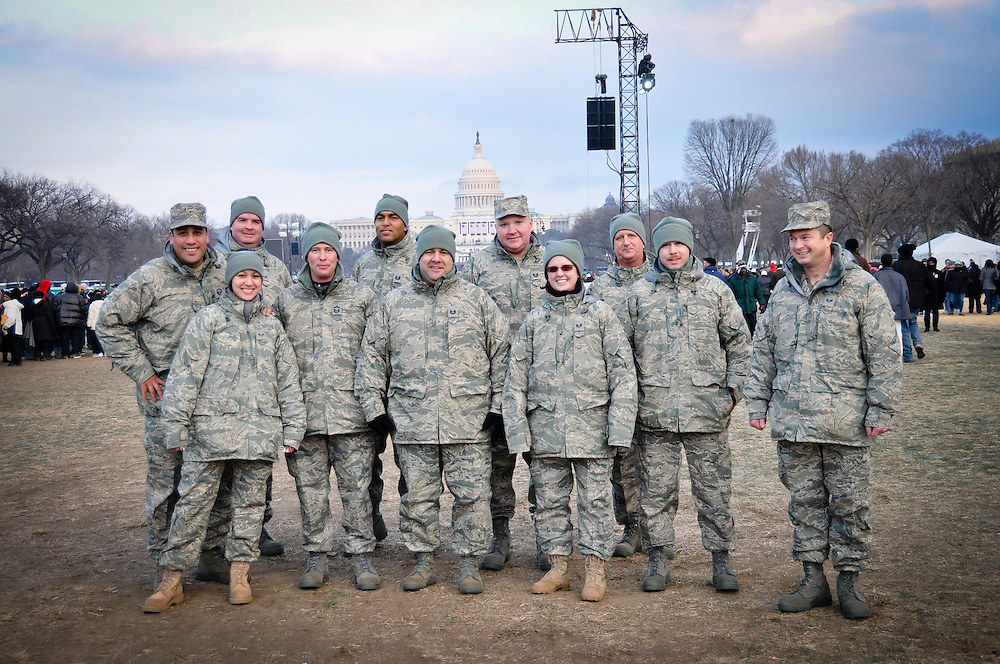 A group of army recruits pose for a photo with the US Capitol building in the background.