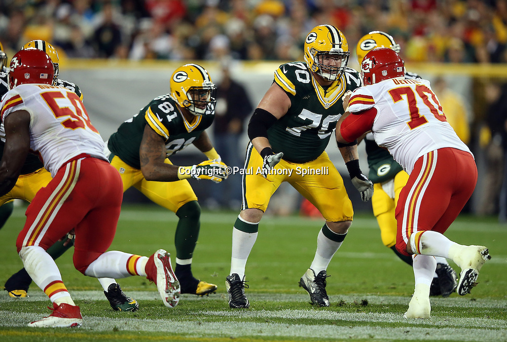 Green Bay Packers guard T.J. Lang (70) blocks Kansas City Chiefs defensive end Mike DeVito (70) during the 2015 NFL week 3 regular season football game against the Kansas City Chiefs on Monday, Sept. 28, 2015 in Green Bay, Wis. The Packers won the game 38-28. (©Paul Anthony Spinelli)