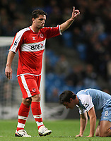Photo: Paul Thomas.<br /> Manchester City v Middlesbrough. The Barclays Premiership. 30/10/2006.<br /> <br /> Fabio Rochemback (L) of Middlesborough puts his hand up in protest to the foul on Man City's Joey Barton (R).