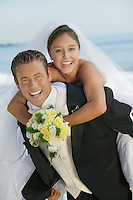 Groom Giving Bride a Piggyback Ride