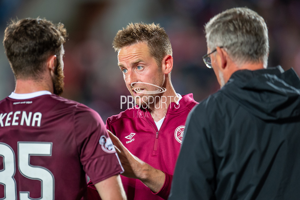 Steven MacLean (#18) of Heart of Midlothian FC speaks with Aidan Keena (#35) of Heart of Midlothian FC and Heart of Midlothian manager Craig Levein before the first period of extra time during the Betfred Scottish Football League Cup quarter final match between Heart of Midlothian FC and Aberdeen FC at Tynecastle Stadium, Edinburgh, Scotland on 25 September 2019.