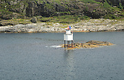 Navigation marker beacon for shipping on small rocky island, north of Bergen,  Norway