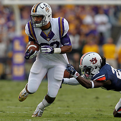 October 22, 2011; Baton Rouge, LA, USA; LSU Tigers wide receiver James Wright (82) breaks away from a tackle by Auburn Tigers defensive back T'Sharvan Bell (22) during the second half at Tiger Stadium. LSU defeated Auburn 45-10. Mandatory Credit: Derick E. Hingle-US PRESSWIRE / © Derick E. Hingle 2011