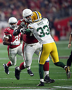 Arizona Cardinals guard Mike Iupati (76) lead blocks for Arizona Cardinals running back David Johnson (31) while Green Bay Packers strong safety Micah Hyde (33) defends during the NFL NFC Divisional round playoff football game against the Green Bay Packers on Saturday, Jan. 16, 2016 in Glendale, Ariz. The Cardinals won the game in overtime 26-20. (©Paul Anthony Spinelli)
