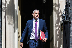 London, UK. 7 May, 2019. Stephen Barclay MP, Secretary of State for Exiting the European Union, leaves 10 Downing Street following a Cabinet meeting.