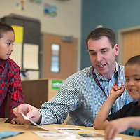 Joel Copely, Principal for Catherine A. Miller Elementary School in Churchrock, assists two kindergarten students, Tony Emerson, left and Luke Davis Tuesday.