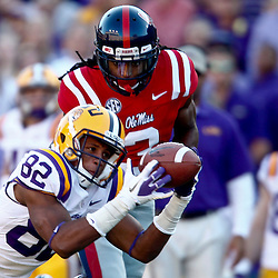 November 17, 2012; Baton Rouge, LA, USA;  LSU Tigers wide receiver James Wright (82) catches a pass over Ole Miss Rebels defensive back Charles Sawyer (3) during the first half of a game at Tiger Stadium.  Mandatory Credit: Derick E. Hingle-US PRESSWIRE