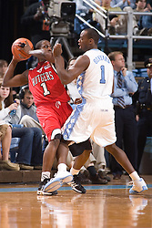 28 December 2006: North Carolina Tarheel guard (1) Marcus Ginyard defends Rutgers guard (1) Marquis Webb during a 87-48 Rutgers Scarlet Knights loss to the North Carolina Tarheels, in the Dean Smith Center in Chapel Hill, NC.<br />