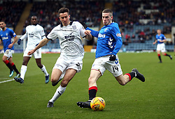 Dundee's Cammy Kerr (left) and Rangers' Ryan Kent battle for the ball during the Scottish Premiership match at Dens Park, Dundee.