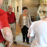 Benny Waycaster, center left, and his wife, Martha, were all smiles Tuesday as they got a look at the St. Jude Dream Home they won on Rowan Oak Drive in Tupelo.