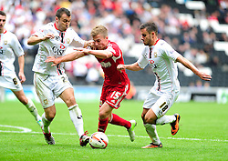 Bristol City's Joe Bryan attempts to break away from Milton Keynes Dons' Antony Kay and Milton Keynes Dons' George Baldock  - Photo mandatory by-line: Dougie Allward/JMP - Tel: Mobile: 07966 386802 24/08/2013 - SPORT - FOOTBALL - Stadium MK - Milton Keynes -  Milton Keynes Dons V Bristol City - Sky Bet League One