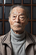 portrait of elderly over 80 years Japanese man looking straight at the camera