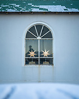 Christmas decorations in window. Vestmannaeyjar islands, Iceland.