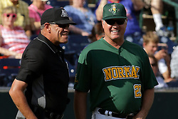 28 May 2017: Umpire Steve Bartelstein. Ryne Sandberg steps in as an assistant coach during a Frontier League Baseball game between the Lake Erie Crushers and the Normal CornBelters at Corn Crib Stadium on the campus of Heartland Community College in Normal Illinois