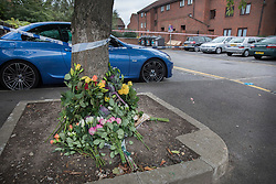 © Licensed to London News Pictures. 08/10/2016. London, UK. Flowers are left at the scene of a shooting in Eastney Road, Croydon. Police were called to reports of a man suffering a gunshot wound at 11.30 PM on Friday night. Officers from the Homicide and Major Crime Command are investigating after the man was pronounced dead at the scene.Photo credit: Peter Macdiarmid/LNP
