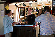 BBC cameraman visits the Sorrel Horse  for a Look East feature about the community purchase of the pub, Shottisham, Suffolk, England