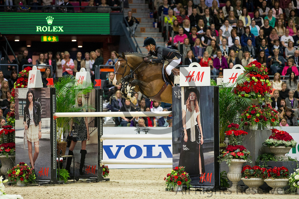 Luciana Diniz - Lennox<br /> Rolex FEI World Cup Final 2013<br /> &copy; DigiShots