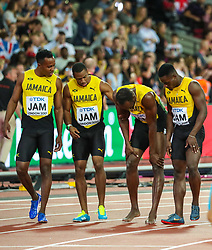 London, August 12 2017 . Usain Bolt stops in agony as he leaves the track with his Jamaican teammates after injuring his hamstring in the final leg of the men's 4x 100m relay on day nine of the IAAF London 2017 world Championships at the London Stadium. © Paul Davey.